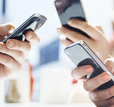 3 hands buzy working on handphones